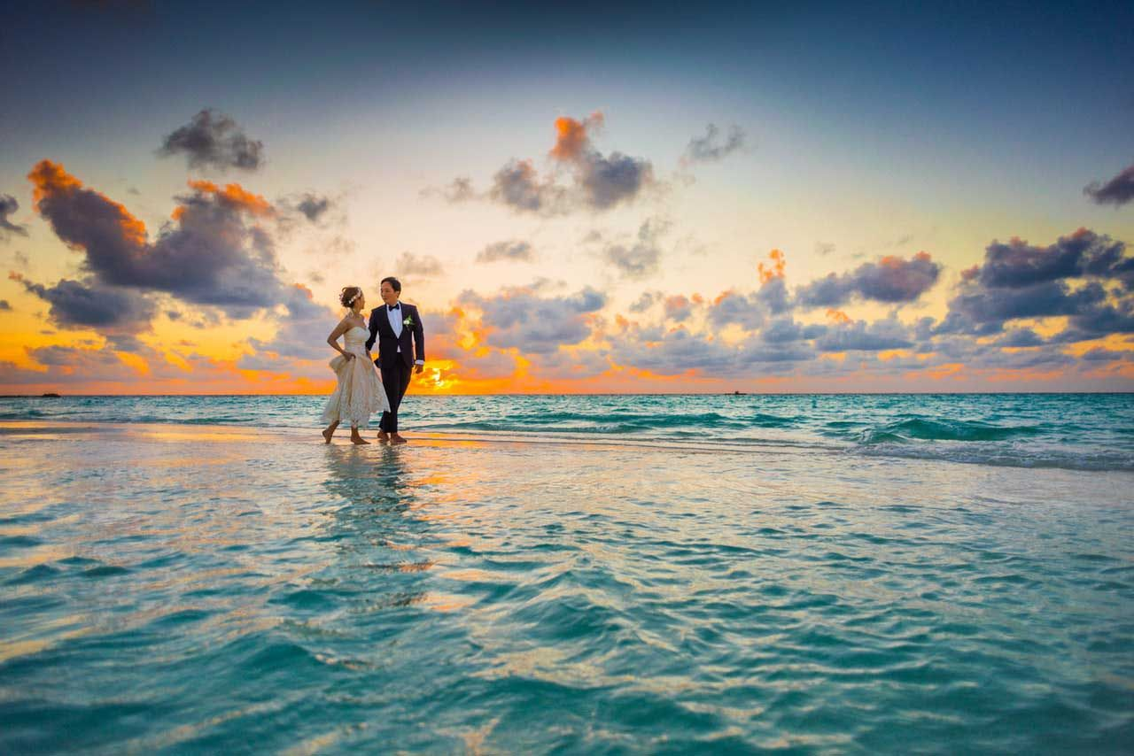 man-and-woman-walking-of-body-of-water-1024993.jpg